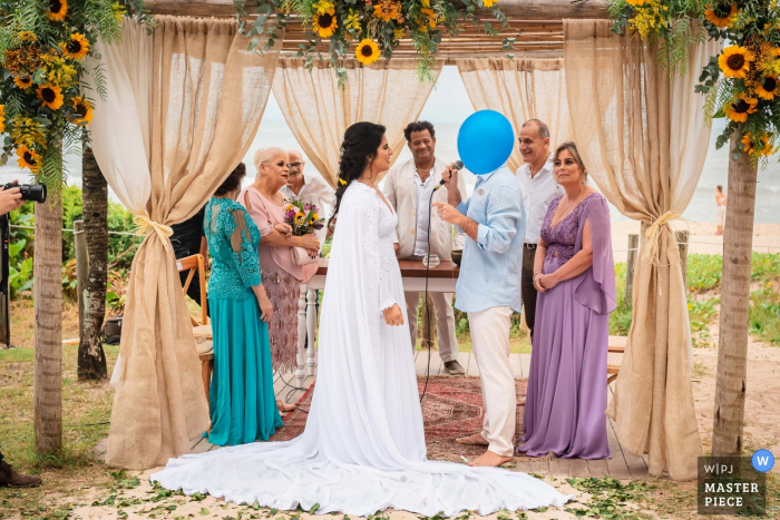 Grumari Beach Garden - Rio de Janeiro - Brazil Outdoor Wedding Ceremony Photography | The blue-headed groom. Balloon during vows. Bride and Groom.