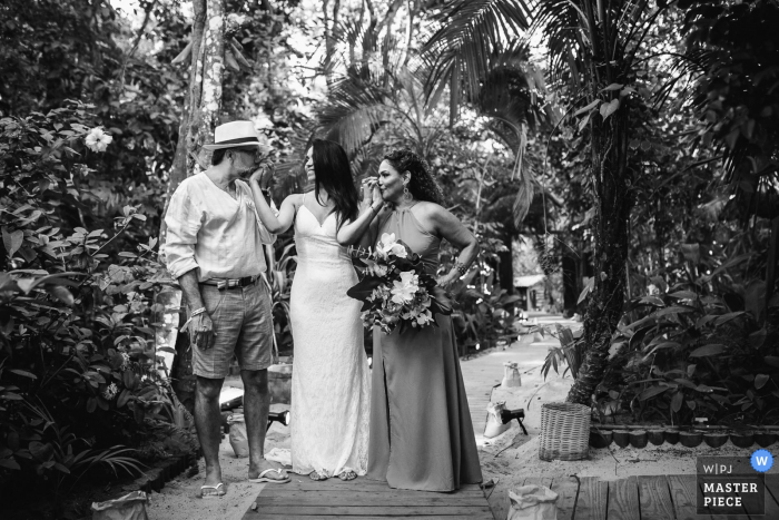 Pousada Bahia Bonita - Trancoso - Bahia - Brazil Wedding Venue Photography   A minute before the bride enters the ceremony, she has her hands kissed by her parents.