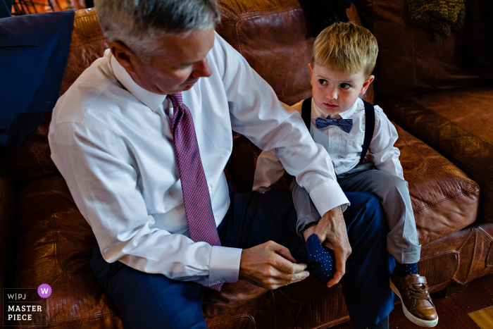Bald Mountain Camps Rangeley Maine Wedding Venue Photography - The bride's son gets dressed with his grandfather at the Maine wedding ceremony