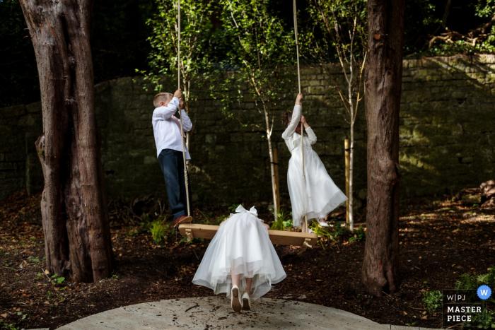 The Orangery, Maidstone, Kent UK Wedding Reportage Photography - The paige boy and flower girls enjoying swining