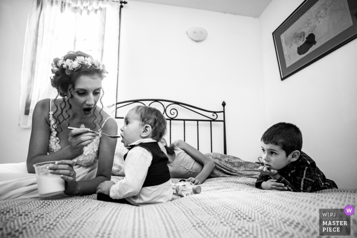Bojenci Vilage, Bulgaria Wedding Day Photography - Bride and Kids Waiting for the groom