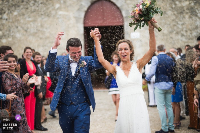 Chateau La Hitte Wedding Photos of Bride and Groom celebrating after ceremony