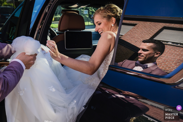 Antwerp Wedding Reportage Photographer - Bride gets Helping Hand while exiting the car