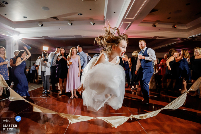 Wedding Photography from Venue Willowbend Country Club, Mashpee, MA - kids on the dancefloor jumping napkin rope