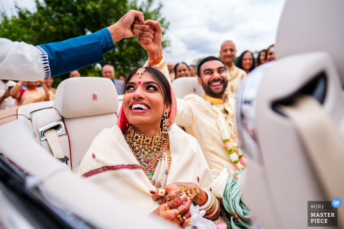 Wedding Photos from North Mymms Park Hertfordshire - Couple leaving after the ceremony in convertible RR