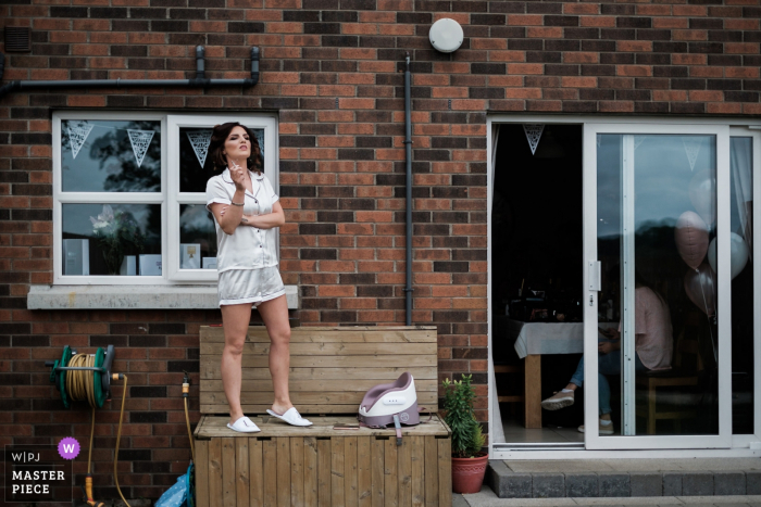 At the bride's home in Lisburn, Northern Ireland - Wedding Reportage Photos - The bride takes a moment out from the morning prep to have a cigarette