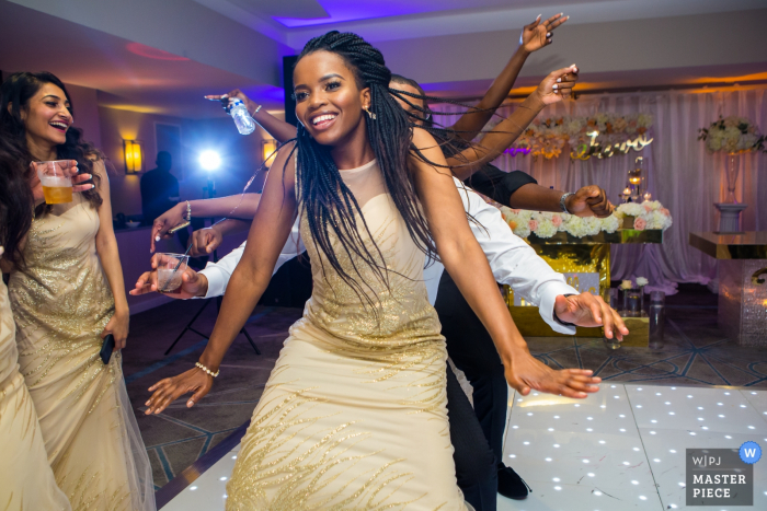 Wedding Reportage Photographer for DoubleTree by Hilton, Docklands, London - Image of bridesmaids dancing