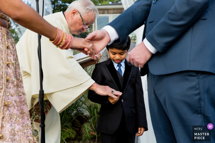 Wedding Photography showing Boy with rings during Soundview Caterers, Bayville Long Island, Ceremony