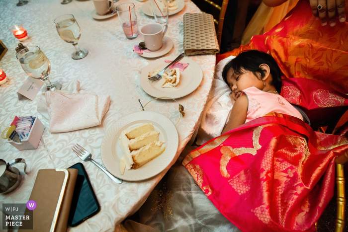 Wedding Photographer shoots at Soundview Caterers, Bayville Long Island, Reception - Girling sleeping at reception table