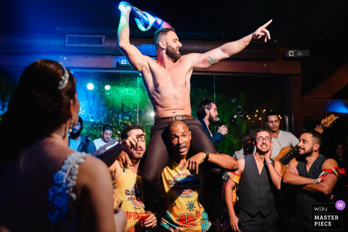 Vale dos Sonhos - Rio de Janeiro - Brazil Wedding Photojournalism - That moment when the groom takes off his shirt and the wedding turns into a carnival.