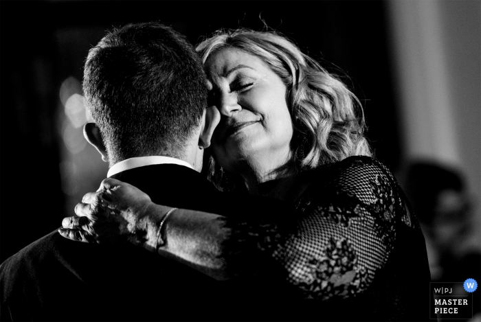 North Carolina Wedding Photojournalism at the Charlotte City Club - The groom dances with his mother.