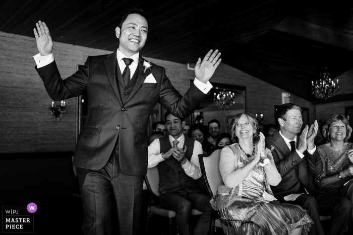 Edgewater Hotel Wedding Photos - Groom walks down aisle for ceremony