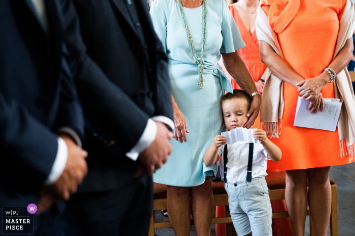 Chateau de la Rocq, Feluy wedding photography at the church with boy reading