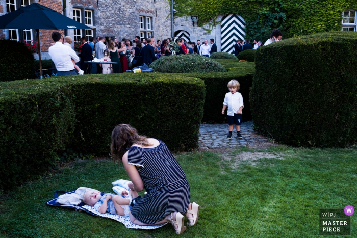 wedding photography at Chateau de la Rocq, Feluy - diaper changing time at the reception party