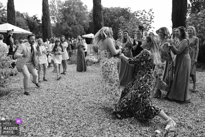 Wedding photography from Chateau Mas de Montet, France — Two girls caught the bouquet and neither of them wanted to give it up...