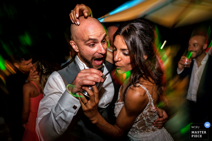 Wedding Location of Reception in Rome - Photography of Bride and Groom dancing and drinking