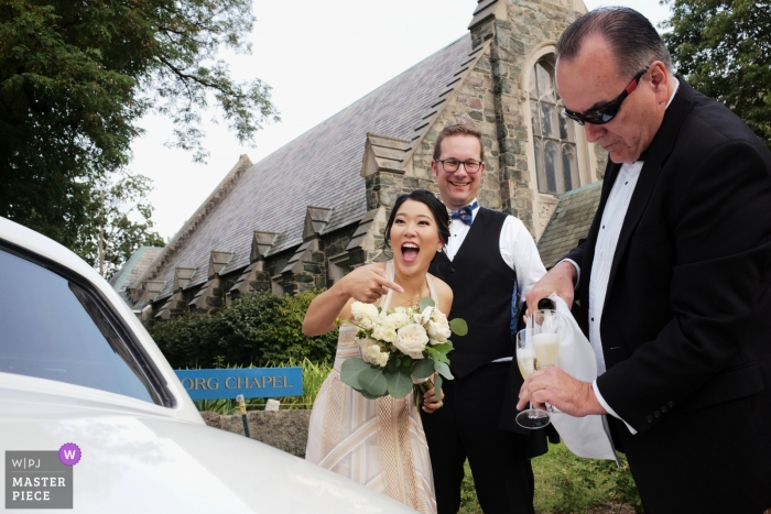 Swedenborg Chapel Cambridge, MA wedding photographer — Bride and Groom being served champagne from limo driver