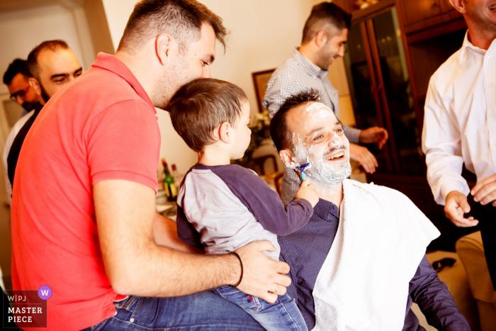 Veria - Greecewedding photographer - Groom shaving with help from little boy