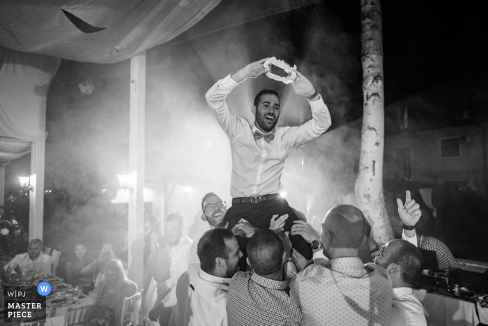 Bulgaria Restaurant Wedding Venue Photography — The garter is mine