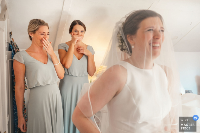 East MidlandsWedding Photographer: I took this just after the bride had got her dress on and as she took a first look at herself in a full length mirror with her bridesmaids behind her. - Brides parents house