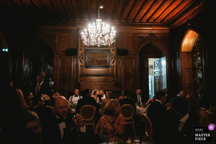 wedding photography at Chateau de Maulmont, France — Bride and groom kissing during the reception