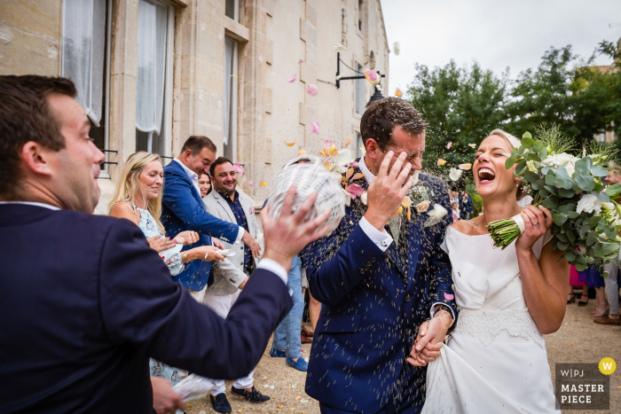 Wedding Venue Photography: Chateau Les Carrasses — Confetti attack on the groom