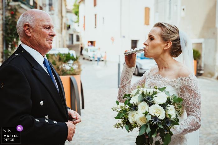 Castres, France Bride drinks brandy - Wedding Reportage