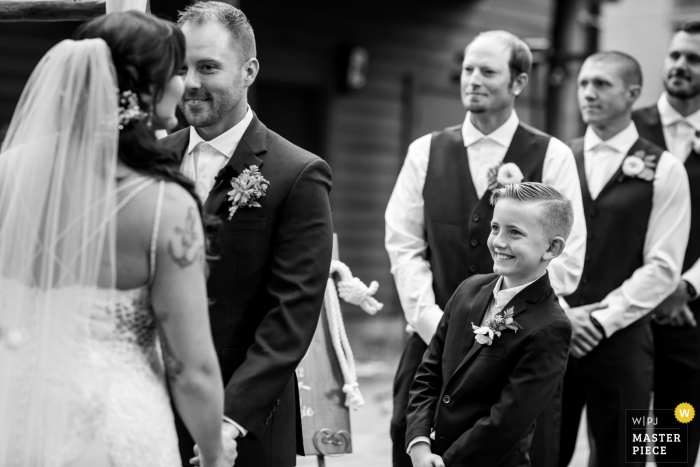 Black Bear Lodge, South Lake Tahoe, CA wedding ceremony photo of a bride's son looks on expectantly during their wedding ceremony in Lake Tahoe, CA