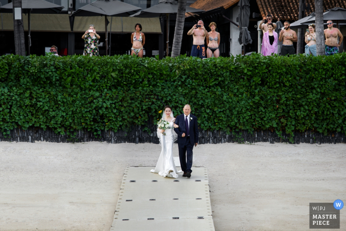 Wedding venue photographer: annli hotel Koh Samui Thailand — The bride enters with her father