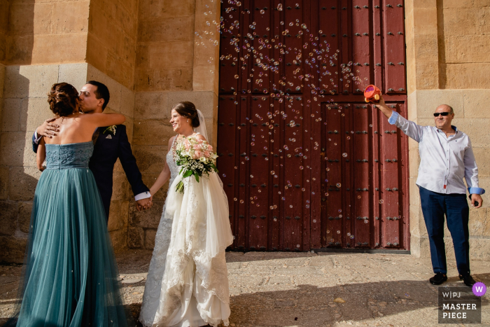 wedding photographer for Catedral de Salamanca — Bubble throwing after ceremony