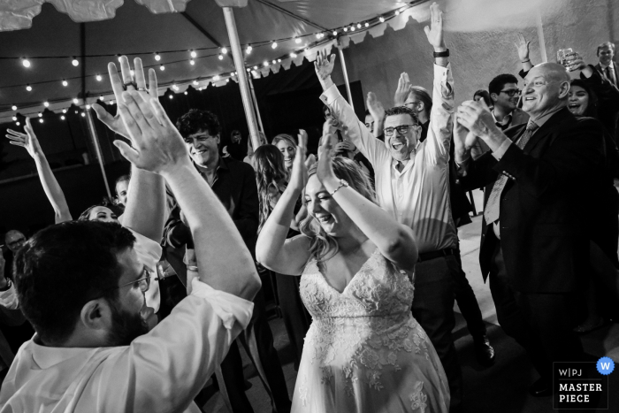 Claremont, CA, Stokers Car Musuem wedding reception image of the bride and groom dancing during their Lebanese wedding traditions