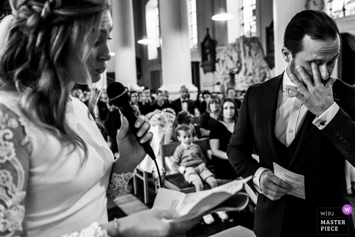 Wallonie church photos at the wedding — emotional bride and groom