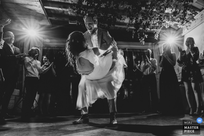 Black and white photo of the bride and groom during the first dance  in Orbey, France.