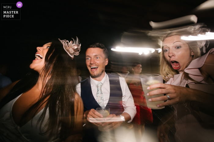 wedding venue photography at the Castello del Trebbio, Tuscany — wedding guests dancing
