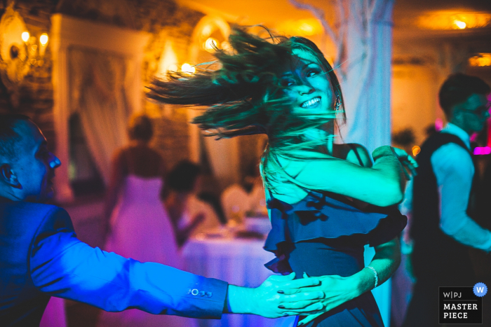 Lodz, Poland wedding reception photographer — Dancing girl at the wedding party.