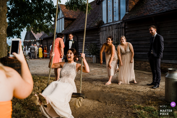 Yoghurt Rooms, West Sussex wedding photography — Never too old to play on a swing...