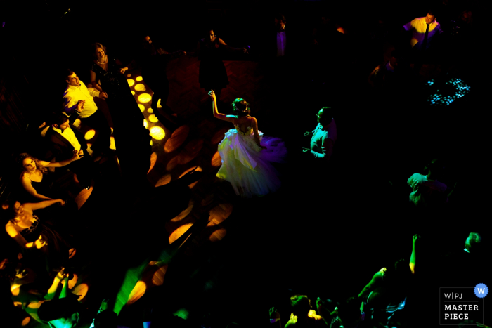 wedding photographer for: Bragadiru Palace Bucharest — bride dance in the middle of a hora ( traditional romanian dance) during the reception