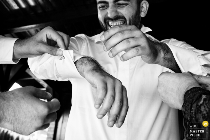wedding photography at Grooms home Tunari | Images showing the Groom getting ready