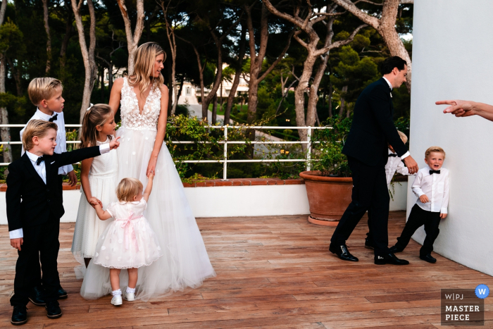 Wedding Photography from Flanders Reception - - The little boy does not want to cooperate for the family portrait and his mother demands he listens and points to the others that are waiting for him
