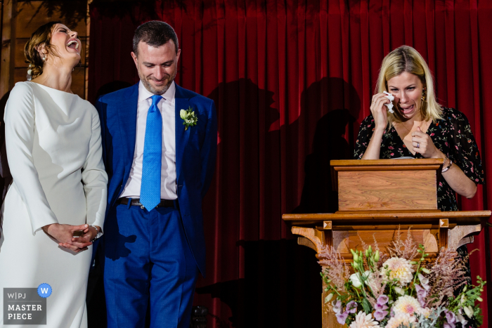 Little Cranberry Island Maine at the Islesford Congregational Church — wedding photography — Tears from the speaker and laughter from the bride on the rainy island wedding day in Maine