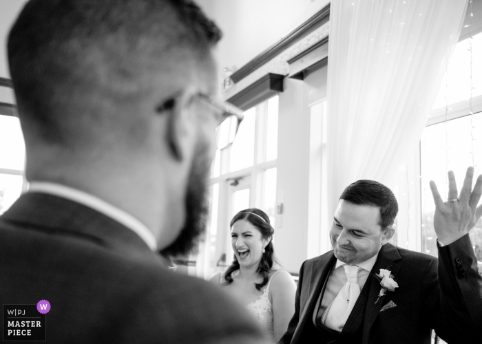Elm Hurst Inn wedding venue photography — Groom and bride reacting to the best man speech