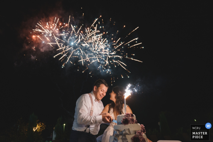 Kranevo, Varna wedding photography below the fireworks - cut the cake - bride and groom at night reception