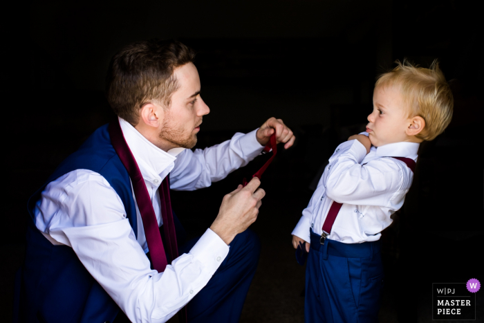 AZ wedding photographer: toddler's reaction to dad attempting to put on his tie