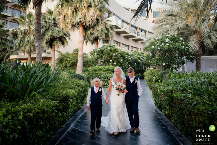 Rixos Hotel The Palm Dubai wedding venue image of the Bride walking to the ceremony with her sons