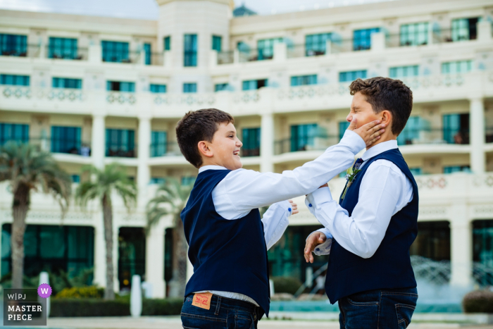 Valencia Spain Pre-Ceremony Wedding Photography - Boys slapping faces outside