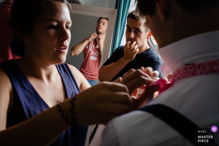 Brussel wedding day photography - wedding party getting ready with ties and suspenders