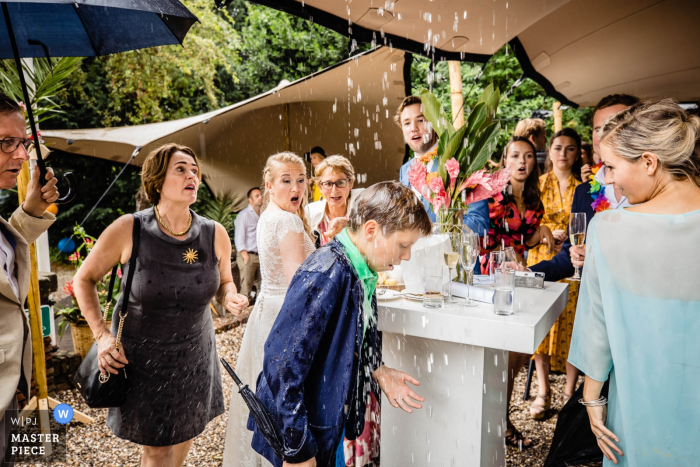 Rotterdam reception photography - wedding day rain gets some guests wet