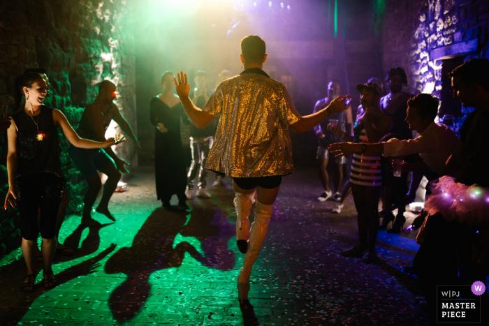 Castello di Rosciano, Umbria, ItalyWedding guests dancing under colorful lights