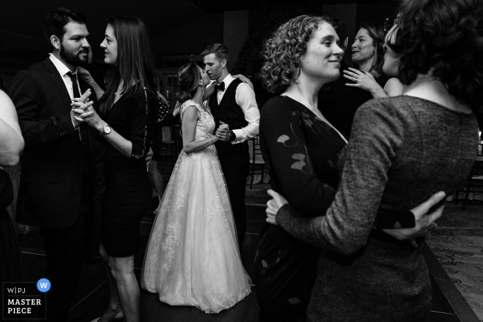 Northport, Maine wedding photographer – A bride and groom slow dance with other guests on their dance floor