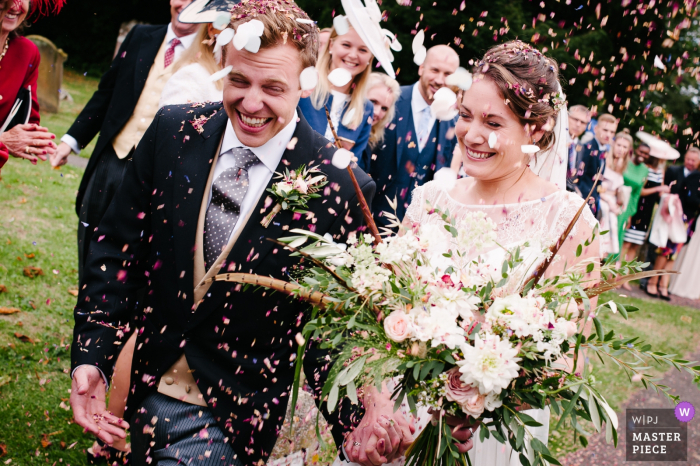 Ceremony Photography from St John the Baptist Church, Meopham, Kent, UK | Happy faces on the confetti run for Kate and Leo